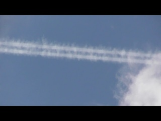 Electric Blue jet plane contrail floating in sky above Cambridge UK 11aug21 225p
