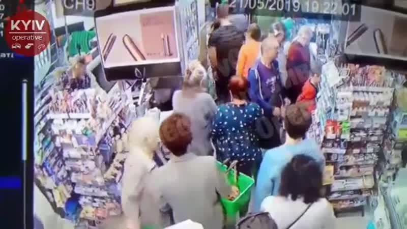 A drunk guy is trying to break a neck to a 9yo kid in Kiev, Ukraine.