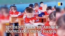 Student in China tries to 'absorb' knowledge from book using hands