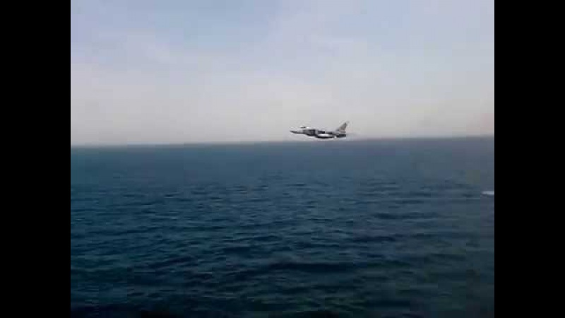 Su-24 of Russian Air Force. Fast flight at very low level over the Sea.