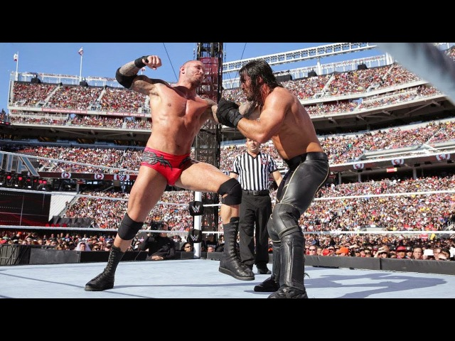 Randy Orton hits Seth Rollins with a jaw dropping RKO out of nowhere WrestleMania 31
