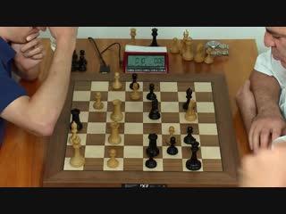 Le jeu prcis de Garry Kasparov force Fabiano Caruana  abandonner