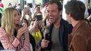 Jude Law and Eddie Redmayne join Harry Potter fans at Kings Cross Station, London