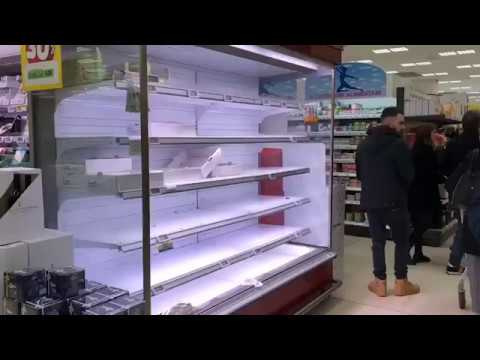 Empty shelves and long queues in supermarkets of Milan Northern Italy MilanItaly CoronavirusOutbreak