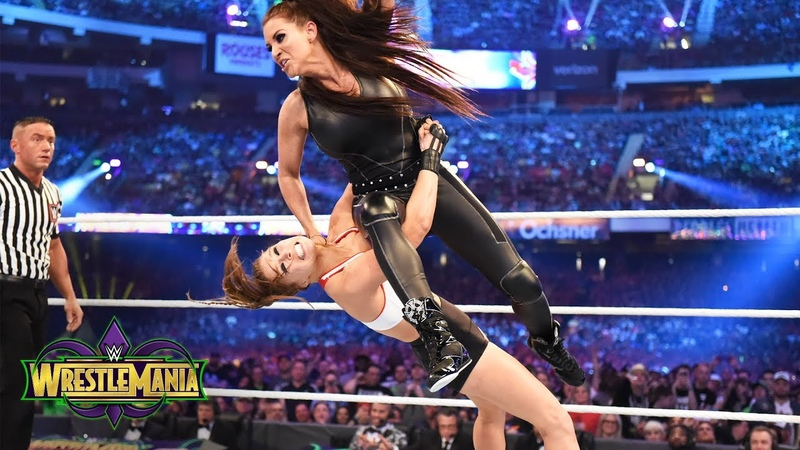 Ronda Rousey shows no mercy against Stephanie McMahon in her WWE in-ring debut WrestleMania 34