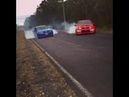 Red R8 hsv maloo doing a burnout on a bush road